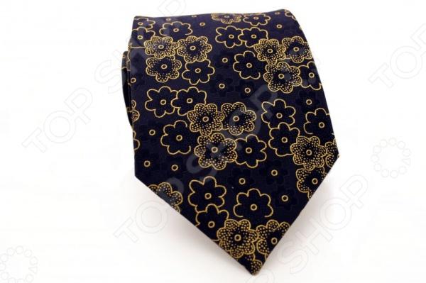 Галстук Mondigo 44720Галстуки. Бабочки. Воротнички<br>Галстук Mondigo 44720 - элегантный мужской галстук ручной работы, выполненный из шелка, который обладает хорошими гигиеническими свойствами и особым блеском. Галстук темно-синего цвета, украшен красивым цветочным узором. Края галстука обработаны лазерным методом. На обратной стороне галстука находится простроченная шелковая нитка, которая позволяет регулировать длину изделию. Такой стильный галстук будет очаровательно смотреться с мужскими рубашками темных и светлых оттенков. Необычный дизайн дополнит деловой стиль и придаст изюминку к образу строгого делового костюма. Женщины также могут дополнить свой образ этим аксессуаром.<br>