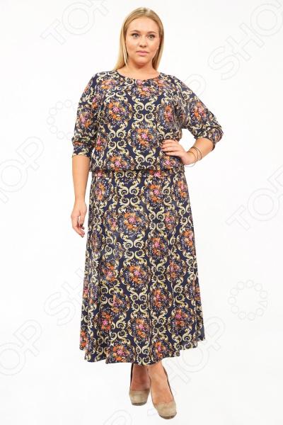 Костюм Матекс «Колорит»Домашние комплекты<br>Костюм Матекс Колорит создан с учетом всех особенностей женской фигуры, чтобы вы могли оставаться неотразимой даже дома. Благодаря продуманному дизайну костюм идеально подойдет женщинам с любым типом фигуры и любого возраста. Он состоит из двух вещей, которые можно носить комплектом или по отдельности:  Блуза свободного кроя, рукава 3 4. Внизу есть манжета, с помощью которой можно регулировать высоту посадки. Круглый вырез горловины  Юбка в пол. На талии удобная резинка. Костюм изготовлен из ткани, состоящей на 100 из полиэстера. Швы обработаны текстурированными эластичными нитями, что предотвращает натирание кожи.<br>