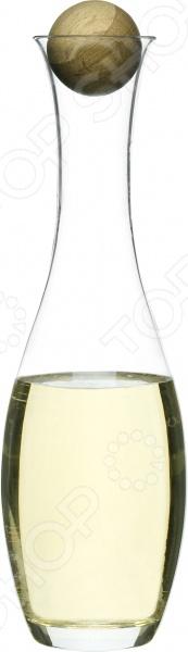 Графин для вина и воды с пробкой Sagaform 5015336 - симпатичный графин, выполненный из стекла, легко очищается под проточной водой. Удобен для хранения различных жидкостей. Имеет более раскрытую вввп горловину, которая позволяет легко и удобно разливать содержимое графина в стаканы или кружки. Деревянный шарик служит в качестве закрывающей крышки, чтобы защитить жидкость от пыли и сора. Графин будет красиво смотреться с любой сервировкой стола. Помещен графин в подарочную упаковку и может стать прекрасным презентом для близкого человека.