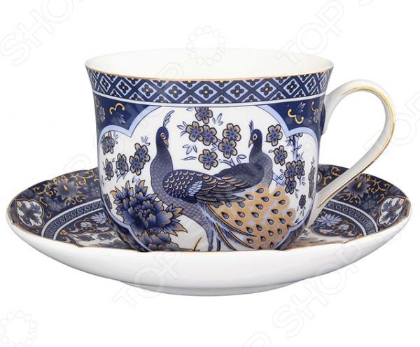 Чайная пара Elan Gallery «Павлин синий»Чайные и кофейные пары<br>Не секрет, что любые блюда и напитки требуют особой подачи и сервировки. Это позволяет вам и вашим гостям насладиться не только их прекрасным вкусом, но и получить настоящее эстетическое удовольствие. Не исключением является и чай, для подачи которого используются чайные сервизы или, так называемые, чайные пары. Чайная пара Elan Gallery Павлин станет отличным дополнением к набору вашей посуды и прекрасно подойдет для сервировки стола. В набор входит блюдце и чайная чашка объемом 400 мл. Посуда выполнена из высококачественной керамики и украшена ярким оригинальным рисунком.<br>