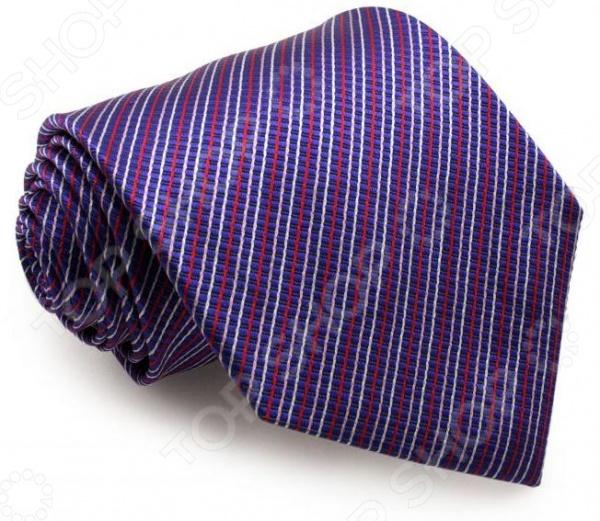 Галстук Mondigo 44001Галстуки. Бабочки. Воротнички<br>Галстук Mondigo 44001 завершающий штрих в образе солидного мужчины. Сегодня классический стиль в одежде приветствуется не только на работе в офисе. Многие люди предпочитают в качестве повседневной одежды костюм или рубашку с галстуком. Мужчина, выбирающий такой стиль в одежде, всегда выделяется среди окружающих и производит положительное первое впечатление. Кроме того, один и тот же галстук можно носить по-разному каждый день. Достаточно выбрать один из многочисленных типов узлов: аскот, балтус, кент, пратт и многие другие. Кстати, в интернете есть сайты, которые случайным образом предлагают вариант узла удобно, когда трудно определиться с выбором . Галстук изготовлен из шелка. Ткань довольно прочная, приятная на ощупь и отличается роскошным блеском. С обратной стороны галстук прострочен шелковой ниткой, что позволяет регулировать длину изделия.<br>