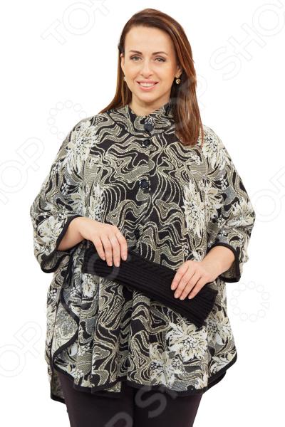 Пончо Milana Style «Верона»Верхняя одежда<br>Пончо Milana Style Верона это универсальная накидка, которая подойдет на любой возраст и стиль одежды, подойдет как для праздничных мероприятий, так и для повседневной носки. Выделка шерсти, фактурный рисунок и необычный дизайн, делает эту вещь уникальной. Классический крой и удобная длина до середины бедра будут идеально смотреться на женщинах с любым типом фигуры и любого возраста. Пончо свободного силуэта с короткими рукавами, подчеркивающими форму женской руки. Воротник стойка с застежкой на пуговицы удлиняет шею и украшает область декольте, а широкие рукава скрывают недостатки в области плеч. Всеми любимый узор цветы всегда актуален для любой модницы, а широкая однотонная окантовка по деталям подчеркивает силуэт модели. На фотографии пончо представлено с брюками Уран . В подарок идут митенки. Материал очень приятный к телу шерсть 30 ; пан 70 , прекрасно подойдет для прохладной осенней погоды. Такая ткань не линяет, не скатывается, формы от стирки не теряет.<br>