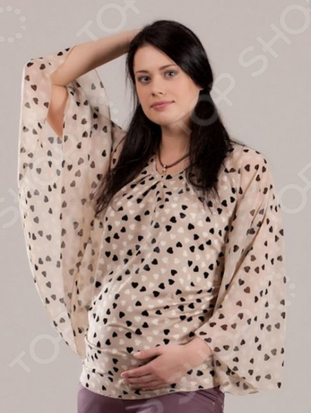 Блузка для беременных Nuova Vita 1345.1 подчеркнет ваш изысканный вкус и поможет создать женственный и гармоничный образ. Модель универсальна, прекрасно подходит для повседневного ношения и хорошо смотрится как с брюками, так и с юбками. Блуза выглядит очень нарядно, снабжена расклешенными рукавами и украшена оригинальным принтом в сердечко . Благодаря свободному силуэту, она не стесняет движений, удобна и практична в носке. Блуза отличается стильным дизайном и великолепным качеством пошива; выполнена из смеси вискозы и лайкры. Эти материалы отлично зарекомендовали себя в производстве одежды, благодаря легкости, прочности и устойчивости к истиранию.