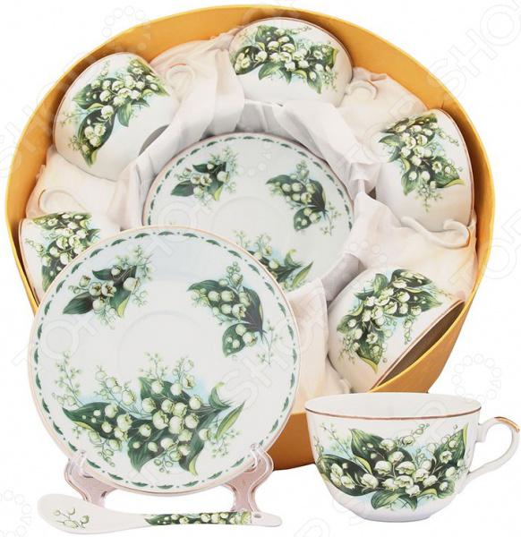 Чайный набор Elan Gallery «Ландыши»Чайные и кофейные наборы<br>Чайный набор Elan Gallery Ландыши превосходный комплект на шесть персон, который станет великолепным украшением стола. Все элементы выполнены из качественной керамики, которая считается одним из лучших материалов изготовления посуды для чаепития и кофепития. Благодаря своим уникальным свойствам, керамика хорошо удерживает тепло и очень богато смотрится на столе. Чайный сервиз состоит из 18 предметов, которые понадобятся для полноценного чаепития. К каждой чашке предусмотрено блюдце и чайная ложка, которые идеально дополняют индивидуальный комплект. Все элементы украшены цветочным узором на белом фоне, который придает набору утонченность. Из этих изящных кружек приятно пить, медленно смакуя и наслаждаясь горячим напитком. Все элементы соединяются в восхитительную чайную композицию, которая станет элегантным и полезным подарком родственнику, коллеге или близкому другу. Этот чайный сервиз подходит для праздничного стола и является великолепным подарком для любого случая!<br>
