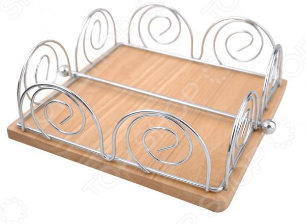 Салфетница Regent TrinaСалфетницы. Держатели зубочисток<br>Салфетница Regent Trina оригинальный и полезный элемент кухонной утвари, который привнесет некоторое разнообразие в интерьер вашей кухни. Он будет уместно смотреться как дома, так и в кафе или на даче. Кроме своей декоративной функции, салфетница обладает своим функциональным предназначением. С её помощью вы сможете красиво сложить салфетки и разместить их прямо на праздничном или обеденном столе. Салфетница выполнены из стального прутка высокого качества. Этот материал отличается экологичностью, устойчивостью к различным запахам. Подставка имеет оригинальную форму корзинки, которая позволяет расположить с комфортом салфетки размером 21х21 см. Простой и лаконичный дизайн изделия является приятным дополнением, которое, без сомнения, покорит сердце даже самых взыскательных эстетов.<br>