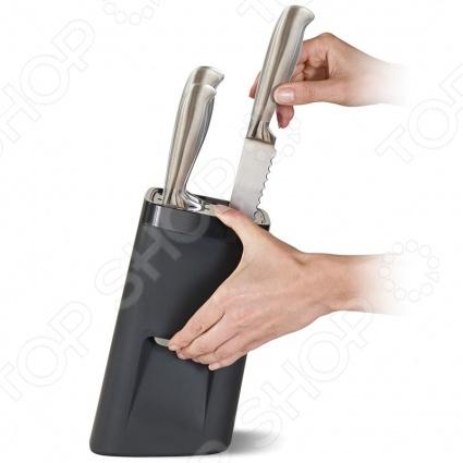 Подставка для ножей Joseph Joseph LockBlockПодставки для ножей. Держатели<br>Подставка для ножей Joseph Joseph LockBlock - удобная и функциональная подставка, которая обезопасит вашу кухню. Как правило, в ящике ножи находятся в открытом доступе и могут поранить вас и ваших детей, к тому же такое хранение ножей приводит к тому, что они быстро тупятся. Ультрабезопасная подставка оснащена системой автоматической блокировки. Данная технология позволит достать нож только тогда, когда вы нажмете на секретную кнопку на боковой панели подставки. Подставка имеет нескользящее основание, которое не позволяет ей двигаться по поверхности стола. Блок подходит для ножей разных размеров и форматов, что делает его универсальным и незаменимым дополнением вашей кухни.<br>