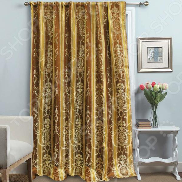 Шторы Amore Mio RR. Тип ткани: жаккард с люрексомШторы<br>Шторы Amore Mio RR. Тип ткани: жаккард с люрексом на шторной ленте роскошное, изящное и качественное изделие, которое наполнит ваше жилище уютом и теплом. Несомненно, от дизайна и расцветки шторы зависит то, насколько комфортно мы будем чувствовать себя в помещении. Ведь любой текстиль на окнах носит не только декоративный характер, но и ограждает нас от шумного и пестрого внешнего мира. Лучшим решением в таком случае является штора из гладкого жаккарда. Ее плотное переплетение подарит вам ощущение уединения и защищенности, но при этом штора не утяжелит помещение. Вплетенная в ткань золотистая нить придает изделию ненавязчивое легкое свечение, а теплая бежево-коричневая расцветка наполнит комнату приятным теплом и уютом. Вы можете украсить шторой гостиную, спальню, кухню или детскую она прекрасно подстроится под цветовую гамму и стиль интерьера.<br>