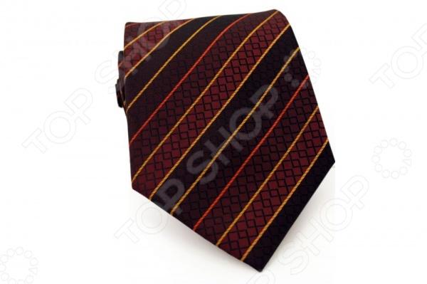 Галстук Mondigo 34367Галстуки. Бабочки. Воротнички<br>Галстук Mondigo 34367 станет важным дополнением гардероба каждого мужчины, ведь стильный и правильно подобранный галстук способен превратить повседневный классический образ мужчины в стильный и современный образ делового человека. Галстук выполнен из высококачественной микрофибры черного цвета и украшен аккуратными диагональными полосками красно-желтых цветов и геометрическими узорами. Модель послужит прекрасным дополнением костюма и будет гармонично смотреться как в офисе, так и на официальных торжественных мероприятиях. В комплекте с галстуком карманный платок размером 23х23 см. Ширина у основания галстука составляет 8,5 см.<br>