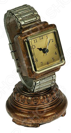 Часы настольные 28513Часы настольные<br>Часы настольные 28513 стильная и практичная модель, которая станет отличным дополнением вашего домашнего или офисного интерьера. Часы оснащены кварцевым механизмом, который обеспечит качественную и бесперебойную работу. Питание осуществляется за счет батареек типа АА. Простой и понятный дизайн часов не будет вас отвлекать от важных дел. Часы имеют форму наручных часов на устойчивой подставке. Надежный корпус выполнен из полистоуна, поэтому за ним легко ухаживать. Благодаря компактному размеру 10х20 см, часы поместятся в любом уголке вашего дома. Полистоун современный материал, который сочетает в себе красоту натурального камня и практичность полимерных материалов. В его основе лежит акриловая смола, гидроксид алюминия и различные пигменты, благодаря чему его структура однородна. Этот материал не впитывает запах, влагу, поэтому не подвержен гниению, развитию бактерий и плесени. Он также устойчив к воздействию солнечных лучей, что позволяет ему сохранять своей первоначальный внешний вид долгие годы.<br>