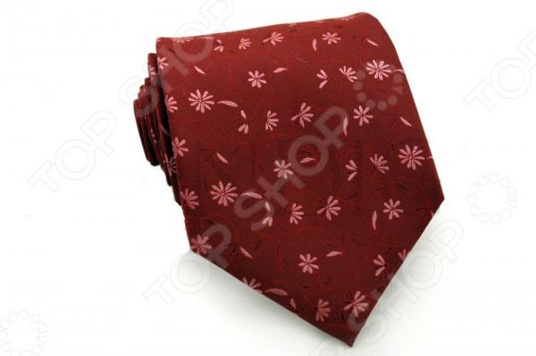 Галстук Mondigo 33425Галстуки. Бабочки. Воротнички<br>Галстук Mondigo 33425 это галстук из высококачественной микрофибры с красивым цветочным узором. Он подходит как для повседневной одежды, так и для эксклюзивных костюмов. Подберите галстук в соответствии с остальными деталями одежды и вы будете выглядеть идеально! В современном мире все большее распространение находит классический стиль одежды вне зависимости от типа вашей работы. Даже во время отдыха многие мужчины предпочитают костюм и галстук, нежели джинсы и футболку. Если вы хотите понравится девушке, то удивить ее своим стилем это проверенный метод от голливудских знаменитостей. Для того, чтобы каждый день выглядеть по-новому нет необходимости менять галстуки, можно сменить вариант узла, к примеру завязать:  узким восточным узлом, который подойдет для деловых встреч;  широким узлом Пратт , который прекрасно смотрится как на работе, так и во время отдыха;  оригинальным узлом Онассис , который удивит всех ваших знакомых своей неповторимый формой.<br>