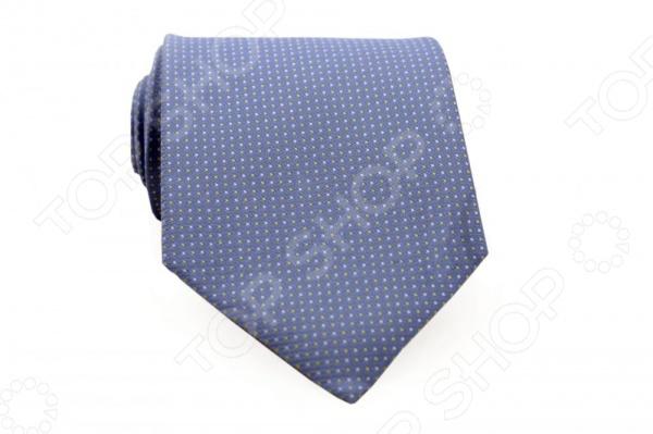 Галстук Mondigo 33607Галстуки. Бабочки. Воротнички<br>Галстук Mondigo 33607 - стильный мужской галстук, выполненный из микрофибры, которая обладает высокой устойчивостью и выдерживает богатую палитру оттенков. Галстук голубого цвета, украшен мелкими точками. Такой стильный галстук будет очаровательно смотреться с мужскими рубашками темных и светлых оттенков. Упакован галстук в специальный чехол для аккуратной транспортировки. Дизайн дополнит деловой стиль и придаст изюминку к образу строгого делового костюма.<br>