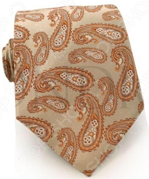 Галстук Mondigo 41002Галстуки. Бабочки. Воротнички<br>Галстук Mondigo 41002 завершающий штрих в образе солидного мужчины. Сегодня классический стиль в одежде приветствуется не только на работе в офисе. Многие люди предпочитают в качестве повседневной одежды костюм или рубашку с галстуком. Мужчина, выбирающий такой стиль в одежде, всегда выделяется среди окружающих и производит положительное первое впечатление. Кроме того, один и тот же галстук можно носить по-разному каждый день. Достаточно выбрать один из многочисленных типов узлов: аскот, балтус, кент, пратт и многие другие. Кстати, в интернете есть сайты, которые случайным образом предлагают вариант узла удобно, когда трудно определиться с выбором . Галстук изготовлен из шелка. Ткань довольно прочная, приятная на ощупь и отличается роскошным блеском. С обратной стороны галстук прострочен шелковой ниткой, что позволяет регулировать длину изделия.<br>