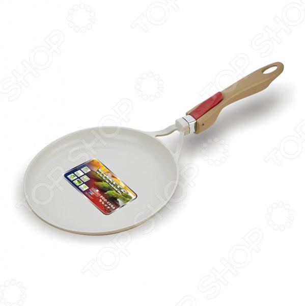 Сковорода блинная Vitesse с керамическим покрытием ECO CERA, изготовлена из высококачественного литого алюминия и оснащена высокопрочной, огнестойкой, ненагревающейся, съёмной бакелитовой ручкой, удобной формы. Внутреннее антипригарное покрытие не позволит пище пригореть и позволит равномерно нагреть и довести блюдо до готовности.