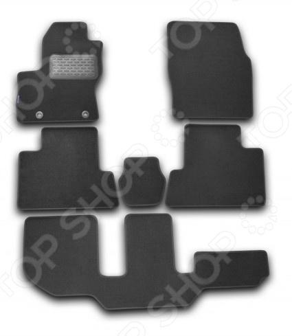 Комплект ковриков в салон автомобиля Novline-Autofamily Ford Grand C-max 2010 универсал. Цвет: черныйКоврики в салон<br>Комплект ковриков в салон автомобиля Novline-Autofamily Ford Grand C-max 2010. Цвет: черный Качественный продукт, новый полимерный материал, антискользящий рельеф, идеальная подходимость, гигиенические сертификаты, экспортируются в западную Европу. Три цвета на выбор - серый, бежевый, черный. Оригинальное наименование: Коврики в салон FORD Grand C-max 2010- , ун., 6 шт. текстиль  Товар, представленный на фотографии, может незначительно отличаться по форме от данной модели. Фотография приведена для общего ознакомления покупателя с качеством исполнения товаров производителя. Комплект ковриков в салон автомобиля Novline-Autofamily Citroen C4 2004-2010 это практичные коврики в салон вашего автомобиля. В наборе вы найдете 5 ковриков из текстиля и полимерного материала, который отличается повышенной износостойкостью, они раскроены в строгом соответствии с контурами пола в салоне. Это исключает необходимость их подрезания или подгиба в случае несоответствия указанным размерам. Можно отметить следующие особенности ковриков:  Качественный полимерный материал, который не портится даже при контакте с зимними химикатами, которые могут попасть на коврик с вашей обуви.  Антискользящий рельеф, вы не будете чувствовать как ноги ездят по полу в момент нажатия на педали.  Выполнено в соответствии с гигиеническими нормами.<br>