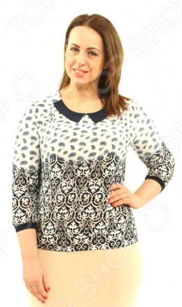 Блузка Milana Style «Леа»Блузы. Рубашки<br>Блузка Milana Style Леа это легкая и нежная блуза, которая поможет вам создавать невероятные образы, всегда оставаясь женственной и утонченной. Благодаря отличному дизайну она скроет недостатки фигуры и подчеркнет достоинства. Блуза прекрасно смотрится с брюками и юбками, а насыщенный цвет привлекает взгляд. В этой блузе вы будете чувствовать себя блистательно как на работе, так и на вечерней прогулке по городу. Универсальная длина до середины бедра делает блузу одеждой на все случаи жизни, а удобные рукава скрывают полноту рук. Блуза полуприлегающего силуэта с элегантным воротником и рукавами длиной . Интересный, тающий узор на кокетке переходит в контрастный орнамент, что смотрится очень современно. Однотонная окантовка по деталям подчеркивает силуэт изделия. Модель выполнена из тонкой ткани, идеально подойдет на весну и прохладное лето вискоза 35 , полиэстер 60 , лайкра 5 , благодаря чему материал не скатывается и не линяет после стирки. Полиэстер очень быстро высыхает после стирки и не мнется. Даже после длительных стирок и использования эта блуза будет выглядеть идеально. Материал является антистатическим и обладает хорошей воздухопроницаемостью.<br>