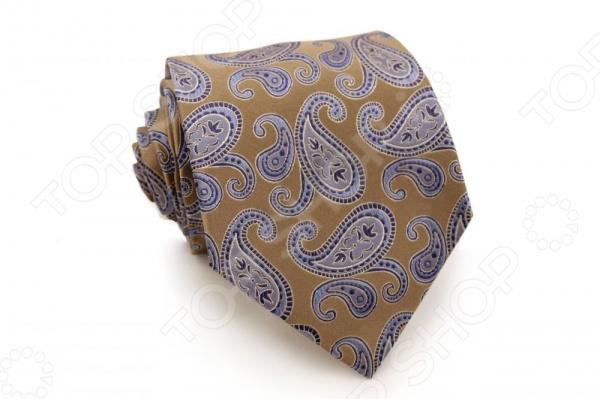 Галстук Mondigo 44282Галстуки. Бабочки. Воротнички<br>Галстук Mondigo 44282 - изящный мужской галстук ручной работы, выполненный из шелка, который обладает хорошими гигиеническими свойствами и особым блеском. Галстук карамельного цвета, украшен восточным принтом пейсли. Края галстука обработаны лазерным методом. На обратной стороне галстука находится простроченная шелковая нитка, которая позволяет регулировать длину изделию. Такой стильный галстук будет очаровательно смотреться с мужскими рубашками светлых оттенков. Необычный дизайн дополнит деловой стиль и придаст изюминку к образу строгого делового костюма.<br>