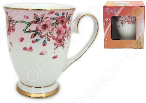 Кружка Elan Gallery «Сакура» 470420Кружки. Чашки<br>Кружка Elan Gallery Сакура 470420 изготовлена из высококачественной керамики и украшена декоративным рисунком. Заварите крепкий, ароматный кофе или чай в представленной модели, и вы получите заряд бодрости, позитива и энергии на весь день! Классическая форма и яркая цветовая гамма изделия позволят наслаждаться любимым напитком в атмосфере еще большей гармонии и эмоциональной наполненности. Кружка Elan Gallery Сакура 470420 является прекрасным подарком для ваших любимых, родных и близких. Внимание! Не рекомендуется применять абразивные моющие средства. Не использовать в микроволновой печи.<br>