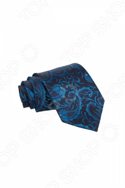 Галстук Mondigo 34889Галстуки. Бабочки. Воротнички<br>Галстук Mondigo 34889 станет важным дополнением гардероба каждого мужчины, ведь стильный и правильно подобранный галстук способен превратить повседневный классический образ мужчины в стильный и современный образ делового человека. Галстук выполнен из высококачественной микрофибры и украшен оригинальным цветочным принтом в восточном стиле. Модель послужит прекрасным дополнением костюма и будет гармонично смотреться как в офисе, так и на официальных торжественных мероприятиях. В комплекте с галстуком карманный платок размером 23х23 см. Ширина у основания галстука составляет 8,5 см.<br>
