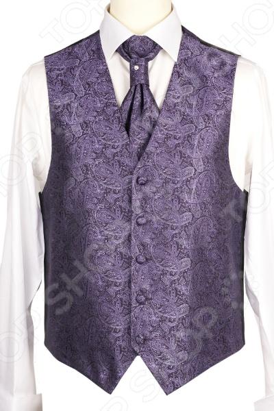 Жилет Mondigo 20637. Цвет: фиолетовыйЖилеты<br>Жилет Mondigo 20637 это деталь классического мужского костюма. Сегодня жилет стал неотъемлемой частью гардероба стильного мужчины, следящего за модными тенденциями. Эта модель отлично будет сочетаться с пиджаком. Жилет также можно использовать и как самостоятельный предмет одежды для создания образа в стиле casual . Жилет это возможная альтернатива пиджаку, при этом он не сковывает движения. Этот предмет одежды позволит создать деловой образ, но чувствовать себя гораздо удобнее в теплое время года.<br>