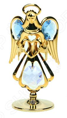 Фигурка декоративная Crystocraft «Ангел» с кристаллами Swarovski 67177Статуэтки и фигурки<br>Фигурка декоративная Crystocraft Ангел с кристаллами Swarovski 67177 это милая статуэтка, которая поможет разнообразить ваш интерьер. В зависимости от своих предпочтений вы можете установить фигурку в гостиной или зале, но она будет отлично смотреться и на прикроватной тумбочке в спальне или на рабочем столе. Такие симпатичные вещицы это еще и отличный способ отдохнуть на работе, если вы работаете на компьютере. Установите фигурку на столе и когда почувствуете усталость просто переведите на неё взгляд. Буквально через несколько минут вы почувствуете, что глаза снова готовы к работе и усталость проходит. Делать такие маленькие перерывы необходимо для вашего здоровья, но очень тяжело если вы целый день смотрите в экран монитора. Эта статуэтка может стать удачным подарком для любого офисного работника. Будьте осторожны, статуэтка очень хрупкая. Ухаживать за ней очень легко, но следует регулярно удалять пыль сухой и мягкой тканью.<br>