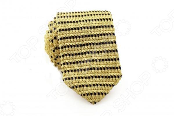 Галстук Mondigo 32031 станет отличным подарком, который не оставит ни одного мужчину равнодушным. Галстук создает непринужденный, молодежный стиль сasual. Изготовлен из материала высокого качества, что гарантирует длительный срок службы. Галстук выполнен из желтой пряжи плотной вязкой и декорирован горизонтальными полосами контрастного, черного оттенка.