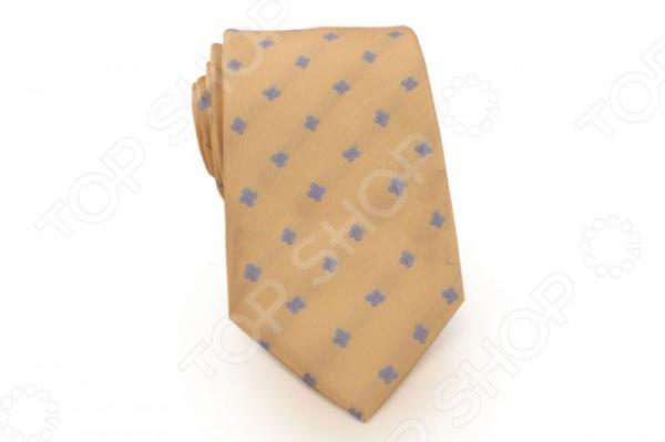 Галстук Mondigo 34364Галстуки. Бабочки. Воротнички<br>Галстук Mondigo 34364 станет важным дополнением гардероба каждого мужчины, ведь стильный и правильно подобранный галстук способен превратить повседневный классический образ мужчины в стильный и современный образ делового человека. Галстук выполнен из высококачественной микрофибры горчичного цвета и украшен стильным принтом. Модель послужит прекрасным дополнением костюма и будет гармонично смотреться как в офисе, так и на официальных торжественных мероприятиях. В комплекте с галстуком карманный платок размером 23х23 см. Ширина у основания галстука составляет 8,5 см.<br>