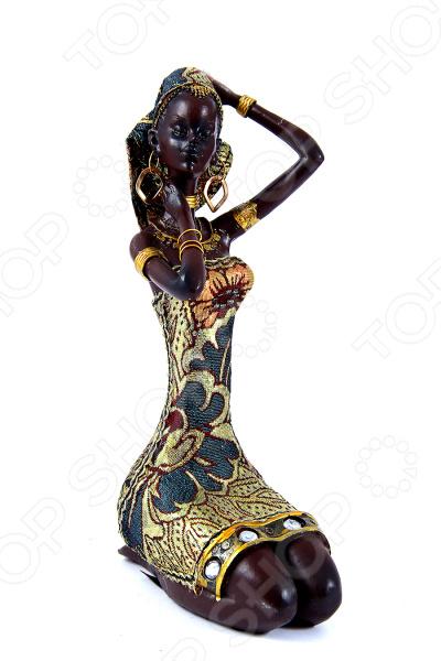 Статуэтка «Африканка» 26146Статуэтки и фигурки<br>Статуэтка Африканка 20146 не только внесет яркий акцент в интерьер вашего дома, но и отлично подойдет в качестве сувенирного подарка родным и близким. Модель выполнена из высококачественных материалов, отличается оригинальным дизайном и великолепным качеством исполнения. Подобные элементы декора широко используются в дизайне интерьера и позволяют придать ему еще больше гармоничности и нетривиальности. В качестве материала изготовления для статуэтки используется искусственный камень, или, как его еще называют полистоун. Данный материал отлично зарекомендовал себя в производстве различных предметов интерьера, благодаря своей экологичности, прочности и устойчивости к высоким температурам и механическим повреждениям. Помимо прочего, он достаточно неприхотлив в уходе: вам будет необходимо всего лишь время от времени протирать статуэтку мягкой тканью от пыли.<br>
