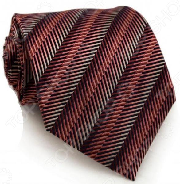 Галстук Mondigo 44221Галстуки. Бабочки. Воротнички<br>Галстук Mondigo 44221 завершающий штрих в образе солидного мужчины. Сегодня классический стиль в одежде приветствуется не только на работе в офисе. Многие люди предпочитают в качестве повседневной одежды костюм или рубашку с галстуком. Мужчина, выбирающий такой стиль в одежде, всегда выделяется среди окружающих и производит положительное первое впечатление. Кроме того, один и тот же галстук можно носить по-разному каждый день. Достаточно выбрать один из многочисленных типов узлов: аскот, балтус, кент, пратт и многие другие. Кстати, в интернете есть сайты, которые случайным образом предлагают вариант узла удобно, когда трудно определиться с выбором . Галстук изготовлен из шелка. Ткань довольно прочная, приятная на ощупь и отличается роскошным блеском. Края обработаны лазерным методом.<br>