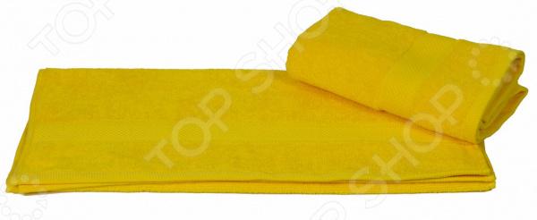 Полотенце махровое Hobby Home Collection Beril. Цвет: желтыйПолотенца<br>Что может приятнее, чем принять расслабляющую ванну или освежающий душ, а затем завернуться в пушистое махровое полотенце К сожалению сейчас не каждое банное полотенце может порадовать своей мягкостью и внешний видом уже после первых двух или трех стирок. Некоторые начинают оставлять на теле ворсинки, а другие нещадно терять свой первоначальный внешний вид. Качественный банный текстиль для вашего дома! Полотенце махровое Hobby Home Collection Beril. Цвет: желтый воплощает в себе удивительную мягкость, высокое качество и удивительную износостойкость. Простой, но стильный дизайн полотенца позволит ему вписаться даже в классический интерьер ванной комнаты. Дизайнеры торговой марки оформили полотенце оригинальным и изысканным декором. Махровое полотенце отличается высокой плотностью в 450 гр м2, благодаря чему оно способно выдержать многочисленные стирки. Яркий и сочный желтый цвет полотенца позволит ему стать гармоничным дополнением ваших банных принадлежностей.  Преимущества данного махрового полотенца:  выполнен из гипоаллергенного натурального хлопка;  благодаря свободной вытяжке основных нитей прекрасно впитывает влагу и быстро высыхает;  сохраняет цвет и форму даже после многократных стирок;  сохраняет мягкость на протяжении многих лет. Порадуйте себя приятными и мягкими прикосновениями с качественным и долговечным махровым полотенцем от торговой марки Hobby Home Collection! Уход: Чтобы изделие прослужило вам как можно дольше рекомендуется стирать при деликатном режиме при температуре не более 40 С. Используйте моющие средства для цветных тканей, тогда насыщенный цвет изделия сохранится надолго.<br>