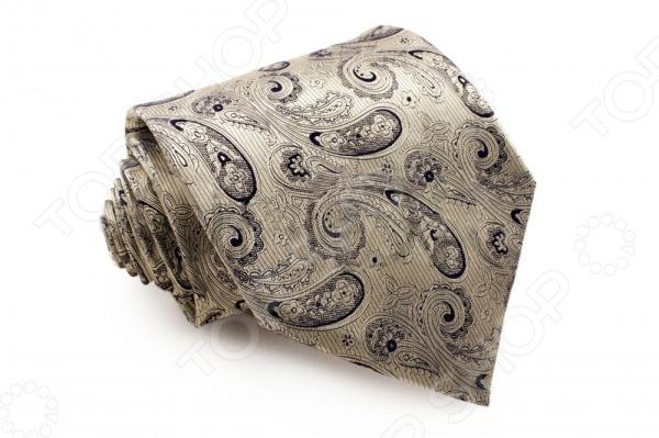 Галстук Mondigo 44102Галстуки. Бабочки. Воротнички<br>Галстук Mondigo 44102 это галстук из 100 шелка, украшен восточно принтом, а края обработаны лазерным методом. Он подходит как для повседневной одежды, так и для эксклюзивных костюмов. Подберите галстук в соответствии с остальными деталями одежды и вы будете выглядеть идеально! В современном мире все большее распространение находит классический стиль одежды вне зависимости от типа вашей работы. Даже во время отдыха многие мужчины предпочитают костюм и галстук, нежели джинсы и футболку. Если вы хотите понравится девушке, то удивить ее своим стилем это проверенный метод от голливудских знаменитостей. Для того, чтобы каждый день выглядеть по-новому нет необходимости менять галстуки, можно сменить вариант узла, к примеру завязать:  узким восточным узлом, который подойдет для деловых встреч;  широким узлом Пратт , который прекрасно смотрится как на работе, так и во время отдыха;  оригинальным узлом Онассис , который удивит всех ваших знакомых своей неповторимый формой.<br>