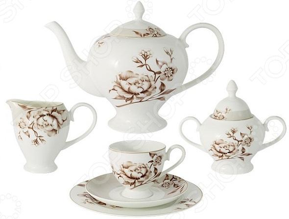 Чайный сервиз Emily «Стефания»Чайные и кофейные наборы<br>Не секрет, что любые блюда и напитки требуют красивой сервировки и особой подачи к столу. Это позволяет вам и вашим гостям насладиться не только их прекрасным вкусом, но и получить от трапезы настоящее эстетическое удовольствие. Не исключением является и чай. В случае с этим, любимым многими, напитком, правильная сервировка играет не то что важную, а одну из ключевых ролей. Не зря для жителей восточных стран чаепитие это целый ритуал. А они, уж поверьте, знают в этом толк! За чашечкой чая Чайный сервиз Emily Стефания станет отличным дополнением к набору посуды и прекрасно подойдет для сервировки праздничного чаепития. Он рассчитан на шесть персон и, помимо традиционных чашек с блюдцами, также включает в себя заварочный чайник, сахарницу, молочник и тарелки. Посуда выполнена из белого костяного фарфора, отличается изысканным дизайном и великолепным качеством исполнения. Все предметы выполнены в одном стиле и украшены изящным цветочным рисунком. Вместе они создают единый ансамбль и стилистически дополняют друг друга.  Комплектация:  6 чайных чашек;  6 блюдец;  6 тарелок;  заварочный чайник;  сахарница;  молочник.  Преимущества посуды Emily  большой выбор дизайнов и расцветок;  использование высококачественного костяного фарфора;  покрытие изделий специальной, не содержащей свинец, глазурью;  возможность мытья в посудомоечной машине и использования в СВЧ-печи при отсутствии золотистого и серебряного декора .  Торговая марка Emily уже на протяжении многих лет пользуется неизменной популярностью на рынке посуды. При создании своей продукции компания использует как традиционные, так и современные тенденции, что позволяет добиться высоких стандартов качества и удовлетворить пожелания любых, даже самых взыскательных, покупателей. Стоит отметить, что над созданием новых дизайнов, декоров и форм трудится целая группа дизайнеров из Англии, Германии и Восточной Азии.<br>