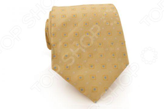 Галстук Mondigo 31040 - стильный мужской галстук, выполненный из микрофибры, которая обладает высокой устойчивостью и выдерживает богатую палитру оттенков. Галстук желтого цвета, украшен геометрическим рисунком из небольших квадратов голубого цвета. Такой стильный галстук будет шикарно смотреться с мужскими рубашками темных и светлых оттенков. Упакован галстук в специальный чехол для аккуратной транспортировки. Дизайн дополнит деловой стиль и придаст изюминку к образу строгого делового костюма.