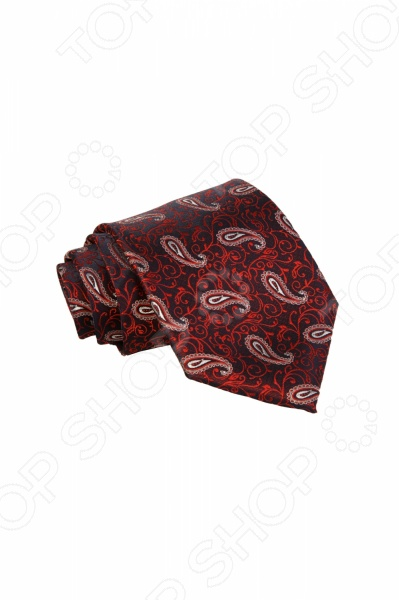 Галстук Mondigo 34860Галстуки. Бабочки. Воротнички<br>Галстук - важный элемент гардероба в жизни каждого мужчины. Сегодня сложно себе представить современного делового мужчину без галстука и это не удивительно, ведь именно галстук является главным атрибутом делового стиля. Не редко, для делового мужчины галстук - одна из немногих деталей, которая позволяет выразить свою индивидуальность, особенно в случаях, когда необходимо соблюдать строгий дресс-код. Однако, галстук уже давно вышел за пределы деловой сферы. Сегодня многие мужчины предпочитающие стиль кэжуал, так же активно прибегают к помощи различных галстуков для создания своего уникального образа. Галстуки стали очень разнообразными как по виду и цвету, так и по форме и материалу изготовления, благодаря этому их можно активно носить не только в офис и на деловых встречах, но даже на отдыхе и в повседневной жизни. Галстук Mondigo 34860 - оригинальная модель, которая станет завершающим штрихом в образе солидного мужчины. Правильно подобранный галстук позволяет эффектно выделить выбранный вами стиль, подчеркнуть изысканность и уникальность его владельца. Стильный мужской галстук бордового цвета, украшен оригинальным цветочным принтом и узором пейсли красного цвета.Ширина у основания 8,5 см.<br>
