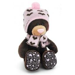 фото Мягкая игрушка Orange сидячая в вязаной шапке с сердечками Milk «Медведь». Размер: 25 см