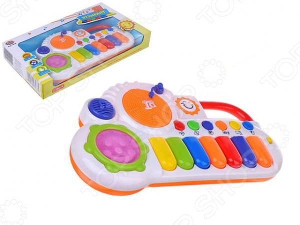 Игрушка музыкальная PlaySmart DJ «Я музыкант»Игрушечные музыкальные инструменты<br>Игрушка музыкальная PlaySmart DJ Я музыкант яркая, многофункциональная игрушка, которая идеально подходит для начального развития малышей. Этот легкий и занимательный музыкальный инструмент выполнен виде оригинального пианино-синтезатора с несколькими кнопками. Такая игрушка будет не только способствовать развитию музыкального слуха малыша, но и развитию мелкой моторики рук. Миниатюрное пианино изготовлено из качественного и безопасного пластика. Легкий вес и удобная форма позволят малышу самостоятельно держать игрушку в руках. Также предусмотрены световые эффекты, которые сделают игру более интересной и увлекательной. Порадуйте своего начинающего музыканта столь интересным и занимательным подарком, как игрушка музыкальная PlaySmart DJ Я музыкант !<br>