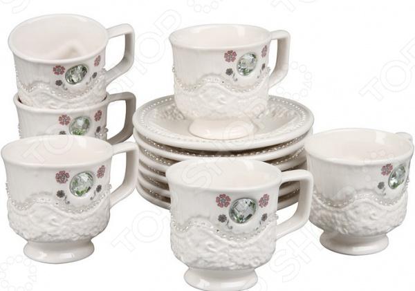 Чайный сервиз Rosenberg 8693Чайные и кофейные сервизы и наборы<br>Чайный сервиз Rosenberg 8693 это симпатичный чайный набор, который станет прекрасным подарком на любой праздник: свадьбу, день рожденья, юбилей или новоселье. Набор выполнен из высококачественного материала, который отличается повышенной износостойкостью и украшен красивым декоративным рисунком. Такой набор станет украшением любого повседневного стола. Комплект поставляется в подарочной коробке, в комплекте 12 предметов:  чашка 170 мл;  блюдце 14х14 см.<br>