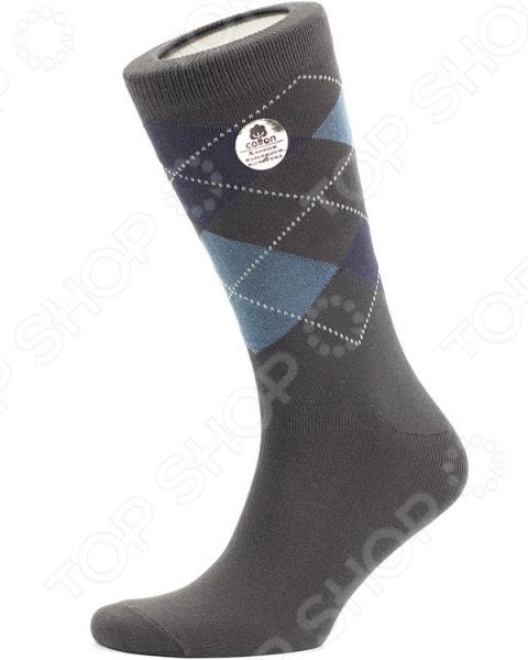 Носки Uomo Fiero MS059. Цвет: серыйМужские носки<br>Носки Uomo Fiero MS059 предназначены специально для мужчин. Представленная модель со средним паголенком отлично подойдет для ежедневной носки или занятий спортом. Пара выполнена в классическом стиле, а благодаря универсальной расцветке, она великолепно сочетается с любой одеждой или обувью. Носки комфортно прилегают к ноге, не образовывая складок. Мягкая двубортная резинка отлично удерживает носок на ноге, не пережимая сосуды. Носки Uomo Fiero MS059 незаменимы в любое время года. Они изготовлены из смеси натуральных и искусственных волокон. Материал изготовления обладает целым рядом отличных потребительских свойств: воздухопроницаемость, гигроскопичность, мягкость, устойчивость к истиранию. Изделие крайне практично и не деформируется после стирки.<br>