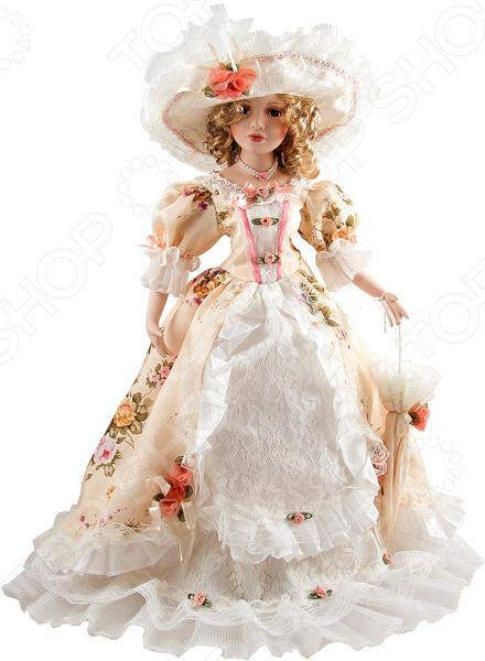 Кукла коллекционная «Елена»Статуэтки и фигурки<br>Кукла коллекционная Елена настоящее произведение искусства, отличающееся невероятной красотой, живостью и реалистичностью исполнения. Нежные пастельные тона в сочетании с легкими материалами создают ощущение воздушности. Изящная и утонченная кукла станет прекрасным украшением интерьера и предметом восхищения всех гостей и домочадцев. У куклы очень доброе лицо и выразительные глаза, пушистые ресницы и светлые кудрявые волосы. Ее роскошный наряд с оборочками и кружевами дополнен аксессуарами чудной шляпкой, колье и зонтом в цвет платья, которые точно не оставят никого равнодушным. Все детали коллекционной куклы продуманы до мелочей. Ее тело пропорционально и гармонично, выполнено из тончайшего фарфора молочного цвета. Такая кукла обязательно займет почетное место на полке и станет источником вашего вдохновения.<br>