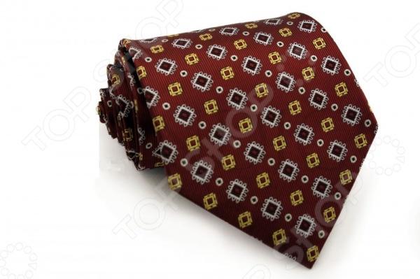 Галстук Mondigo 33293Галстуки. Бабочки. Воротнички<br>Галстук Mondigo 33293 станет важным дополнением гардероба каждого мужчины, ведь стильный и правильно подобранный галстук способен превратить повседневный классический образ мужчины в стильный и современный образ делового человека. Галстук выполнен из высококачественной микрофибры красного цвета с оригинальным рисунком в геометрическом стиле. Модель послужит прекрасным дополнением костюма и будет гармонично смотреться как в офисе, так и на официальных торжественных мероприятиях. В комплекте с галстуком карманный платок размером 23х23 см. Ширина у основания галстука составляет 8,5 см.<br>