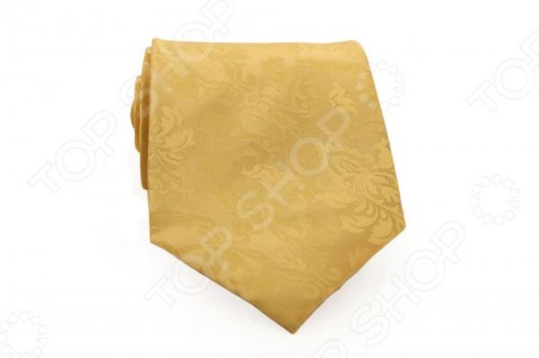 Галстук Mondigo 33765Галстуки. Бабочки. Воротнички<br>Галстук Mondigo 33765 - стильный мужской галстук, выполненный из микрофибры, которая обладает высокой устойчивостью и выдерживает богатую палитру оттенков. Галстук бежевого цвета, украшен орнаментом на фактурной ткани. Такой галстук будет необычно смотреться с мужскими рубашками темных и светлых оттенков. Упакован галстук в специальный чехол для аккуратной транспортировки. Дизайн дополнит деловой стиль и придаст изюминку к образу строгого делового костюма.<br>