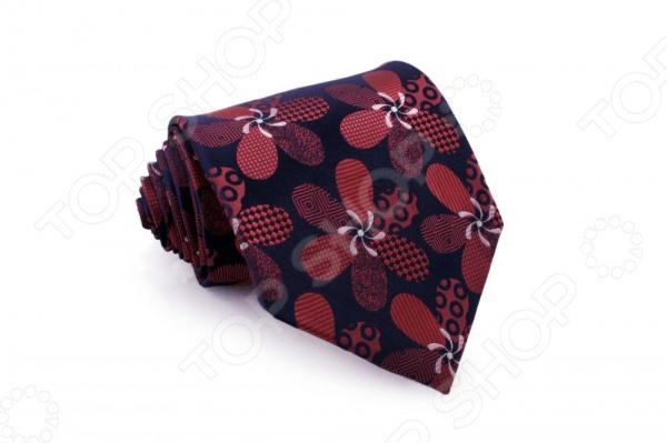 Галстук Mondigo 33191Галстуки. Бабочки. Воротнички<br>Галстук Mondigo 33191 - мужской галстук, выполненный из микрофибры, которая обладает высокой устойчивостью и выдерживает богатую палитру оттенков. Галстук темно-синего цвета, украшен оригинальными цветами с геометрическими элементами красного цвета. Такой стильный галстук будет очаровательно смотреться с мужскими рубашками темных и светлых оттенков. Упакован галстук в специальный чехол для аккуратной транспортировки. Дизайн дополнит деловой стиль и придаст изюминку к образу строгого делового костюма.<br>