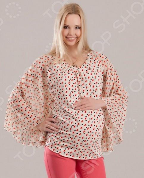 Блузка для беременных Nuova Vita 1345.2 это легкая и нежная блуза, которая поможет вам создавать невероятные образы, всегда оставаясь женственной и утонченной. Благодаря отличному дизайну она скроет недостатки фигуры и подчеркнет достоинства. Блуза прекрасно смотрится с брюками и юбками, а насыщенный цвет привлекает взгляд. В этой блузе вы будете чувствовать себя блистательно как на работе, так и на вечерней прогулке по городу. Универсальная длина до середины бедра делает блузу идеальным выбором на любом сроке беременности, а удобные рукава скрывают полноту рук. Блуза изготовлена из мягкой ткани вискоза 95 , лайкра 5 , благодаря чему материал не скатывается и не линяет после стирки. Вискоза очень быстро высыхает после стирки и не мнется. Даже после длительных стирок и использования эта блуза будет выглядеть идеально. Натуральные ткани позволяют телу дышать, что очень важно для здоровья женщины в период беременности.
