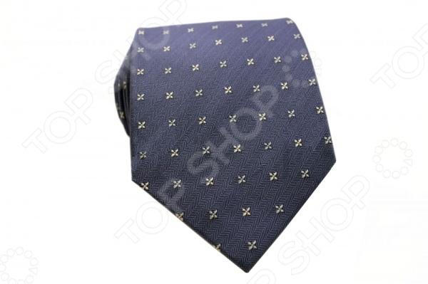 Галстук Mondigo 44740Галстуки. Бабочки. Воротнички<br>Галстук Mondigo 44740 - стильный мужской галстук ручной работы, выполненный из шелка, который обладает хорошими гигиеническими свойствами и особым блеском. Галстук синего цвета имеет узор в виде снежинок на фактурной ткани из елочек схожую с джинсой. Края галстука обработаны лазерным методом. На обратной стороне галстука находится простроченная шелковая нитка, которая позволяет регулировать длину изделию. Такой стильный галстук будет очаровательно смотреться с мужскими рубашками темных и светлых оттенков. Необычный дизайн дополнит деловой стиль и придаст изюминку к образу строгого делового костюма.<br>