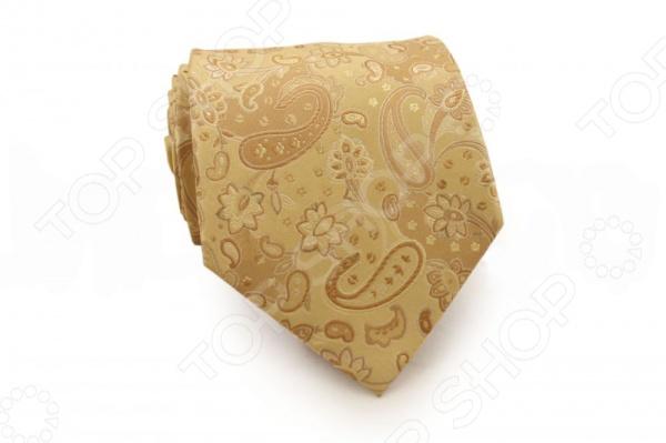 Галстук Mondigo 44343Галстуки. Бабочки. Воротнички<br>Галстук Mondigo 44343 - элегантный мужской галстук, выполненный из шелка, который обладает хорошими гигиеническими свойствами и особым блеском. Галстук бежевцвета,украшен узором пейсли. Края галстука обработаны лазерным методом. На обратной стороне галстука находится простроченная шелковая нитка, которая позволяет регулировать длину изделию. Такой стильный галстук будет очаровательно смотреться с мужскими рубашками темных и светлых оттенков. Необычный дизайн дополнит деловой стиль и придаст изюминку к образу строгого делового костюма.<br>