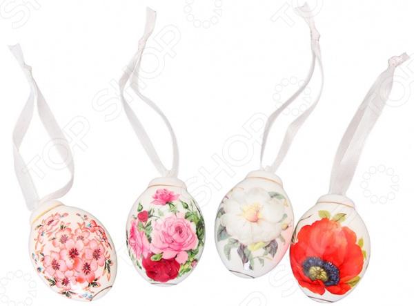 Пасхальный набор Elan Gallery «Цветы»Пасхальный набор Elan Gallery Цветы замечательный комплект, который наполнит святейший пасхальный день домашним теплом и уютом. Символ праздника яйцо, украшенное самыми разнообразными цветами и элементами декора. Преподнести главное пасхальное лакомство еще красивее помогут милые фарфоровые яйца с закрепленными на них ленточками. Цветочный узор в сочетании с приятной расцветкой сделает этот набор великолепным украшением праздничного стола. Вы также можете использовать фарфоровые изделия в качестве подарочной упаковки родные и близкие обязательно оценят красивейшее и необычное обрамление гостинцев. Фарфор, используемый в качестве основного материала, не только красив и изящен, но и прочен. Он не содержит вредные компоненты и прекрасно взаимодействует с продуктами, легко очищается и не впитывает запахи. Фарфор устойчив к повышенным температурам и воздействию различных химических веществ.<br>