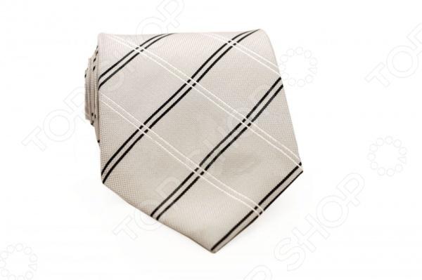 Галстук Mondigo 33685Галстуки. Бабочки. Воротнички<br>Галстук Mondigo 33685 - стильный мужской галстук, выполненный из микрофибры, которая обладает высокой устойчивостью и выдерживает богатую палитру оттенков. Галстук белого цвета, украшен тонкими диагональными полосками. Такой стильный галстук будет очаровательно смотреться с мужскими рубашками темных и светлых оттенков. Упакован галстук в специальный чехол для аккуратной транспортировки. Дизайн дополнит деловой стиль и придаст изюминку к образу строгого делового костюма.<br>
