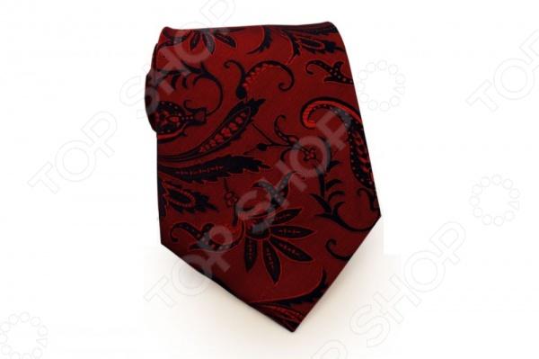 Галстук Mondigo 33364Галстуки. Бабочки. Воротнички<br>Галстук Mondigo 33364 станет важным дополнением гардероба каждого мужчины, ведь стильный и правильно подобранный галстук способен превратить повседневный классический образ мужчины в стильный и современный образ делового человека. Галстук выполнен из высококачественной микрофибры красного цвета и декорирован изящным узором растительных мотивов на фактурной ткани. Модель послужит прекрасным дополнением костюма и будет гармонично смотреться как в офисе, так и на официальных торжественных мероприятиях. В комплекте с галстуком карманный платок размером 23х23 см. Ширина у основания галстука составляет 8,5 см.<br>