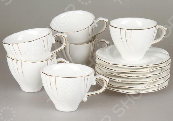 Чайный сервиз Rosenberg 8720Чайные и кофейные наборы<br>Чайный сервиз Rosenberg 8720 станет украшением вашего стола. Красивое оформление стола как праздничного, так и повседневного это целое искусство. Правильно подобранная посуда это залог успеха в этом деле. Такой чайный сервиз придется по вкусу даже самым требовательным хозяйкам и придаст особый шарм и очарование сервируемому столу. В набор входят шесть чашек объемом 175 мл и 6 блюдец.<br>