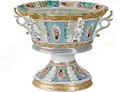 Ваза декоративная Rosenberg R-567Сервировочные блюда и тарелки<br>Ваза декоративная Rosenberg R-567 это красивая сервировочная посуда, которая станет не только полезным дополнением стола, но и отличным украшением любого интерьера. Стильная ваза может похвастаться своей завидной вместительностью, так как состоит из объемной чаши изящной формы, в которой можно подавать все мыслимые и немыслимые сладости для чаепитий любого масштаба. Благодаря своему изысканному и утонченному дизайну, ваза может стать не только идеальным украшением торжественного мероприятия, но и великолепным подарком для ваших близких.<br>