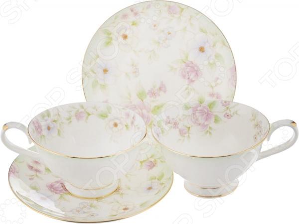 Набор из 2-х чайных пар Elan Gallery «Карнавал цветов»Чайные и кофейные пары<br>Каждая хозяйка знает насколько важна в кулинарии сервировка и правильная подача блюд. От того как блюдо оформлено, в какой посуде подано и как смотрится на тарелке, зависит едва ли не половина вашего успеха. Набор из 2-х чайных пар Elan Gallery Карнавал цветов станет отличным дополнением к набору посуды и прекрасно подойдет для сервировки стола. Посуда выполнена из высококачественной керамики и украшена оригинальным цветочным рисунком. В набор входят две чашки с блюдцами.<br>